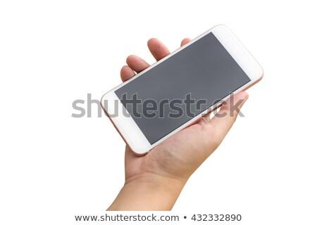 Emberi kéz tart nagy mobil okostelefon izolált Stock fotó © master1305