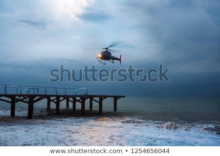 Fény helikopter repülés repülés felhős égbolt Stock fotó © vtls