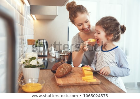 mother preparing kids food Stock photo © LightFieldStudios