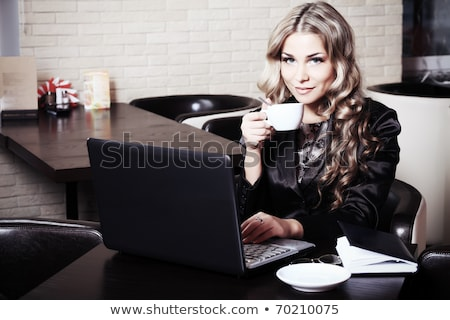 Young woman having tea in caf Stock photo © IS2