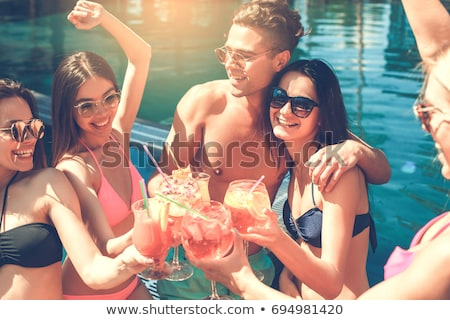 Happy girls with beverages on summer party in the pool Stock photo © dashapetrenko