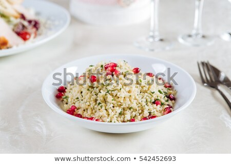 Couscous cereal in plate isolated. Healthy food for breakfast. V Stock photo © MaryValery