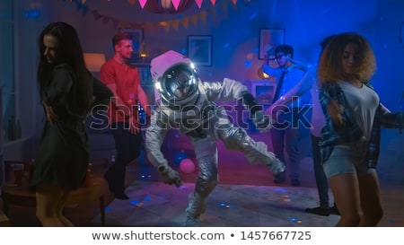 Stock fotó: Female Astronaut Dancing Disco