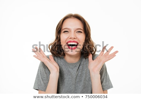 A woman laughing and gesturing to camera Stock photo © IS2