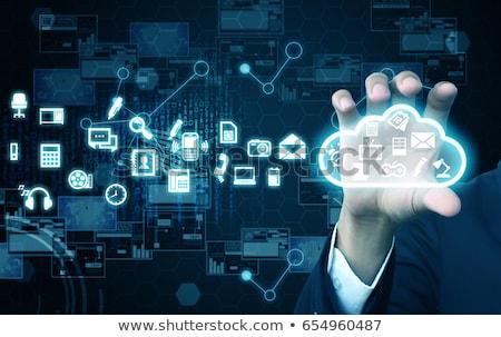 businessman touching virtual cloud hologram stock photo © dolgachov