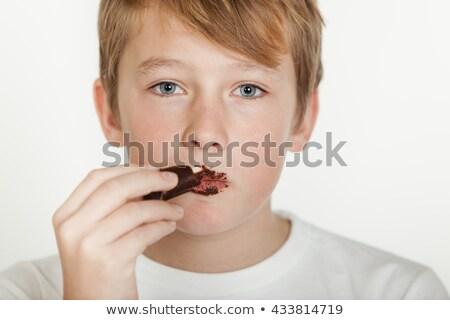 Fiatal srác rendetlen arc fiú eszik aranyos Stock fotó © IS2