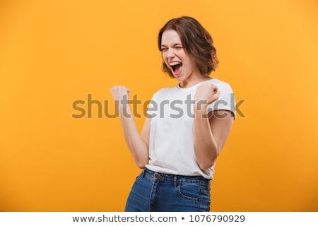 Podniecony młodych pani zwycięzca Zdjęcia stock © deandrobot