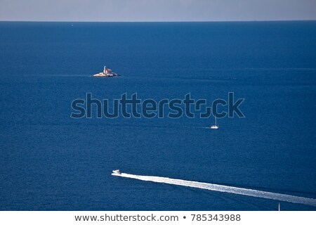 Mulo lighthouse on open sea in Rogoznica archiprelago aerial vie Stock photo © xbrchx