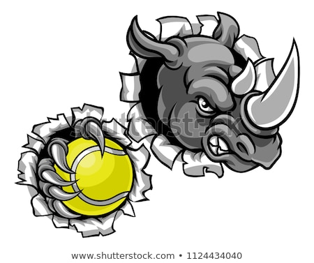 Rhino Holding Tennis Ball Breaking Background Stock photo © Krisdog