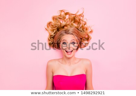 Photo of excited joyful woman with curly hair in summer wear scr Stock photo © deandrobot