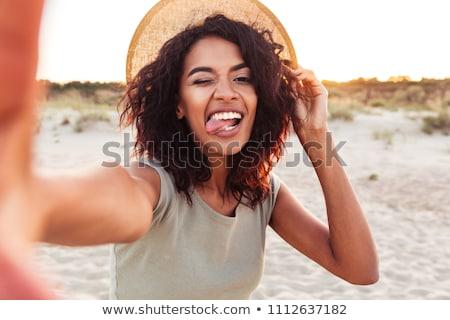 笑みを浮かべて · かわいい · 女性 · 写真 · スマートフォン - ストックフォト © dolgachov