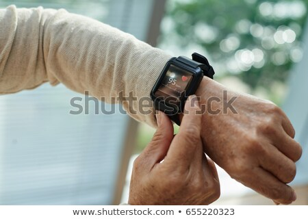 Medical tracker with smartwatch. Stock photo © ra2studio