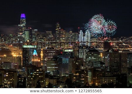 Oakland and San Francisco Downtowns with New Year's Eve 2019 Fireworks Stock photo © yhelfman