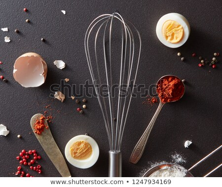 spoon with red pepper metal whisk vintage knife raw egg and flour on a black concrete background w stock photo © artjazz