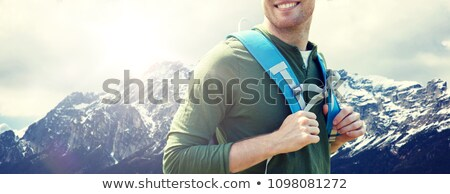close up of man with backpack over alps mountains Stock photo © dolgachov
