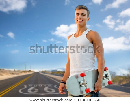 man with skateboard over us route 66 background Stock photo © dolgachov
