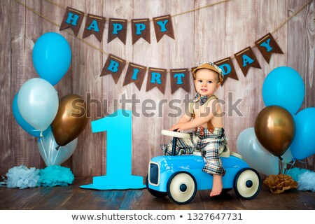 Decorations for one year birthday with blue balloons and inscrip Stock photo © Stasia04