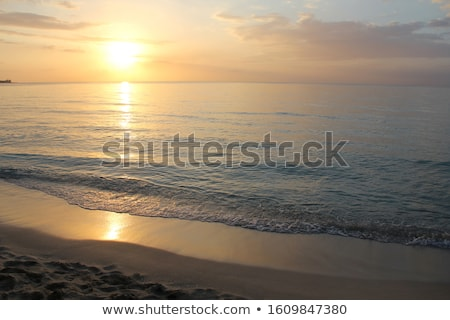 Sun sets over Seven Mile Beach Stock photo © jsnover