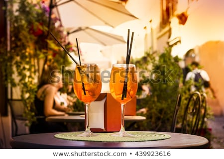 glass of aperol spritz cocktail on the cafe table stock photo © dashapetrenko