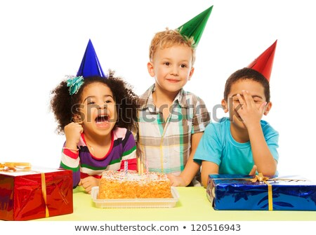 Group of adorable kids having fun at birthday party. African child on the front stock photo © Lopolo