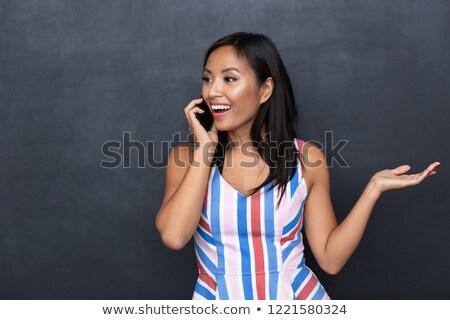 Immagine soddisfatto asian donna 30s parlando Foto d'archivio © deandrobot