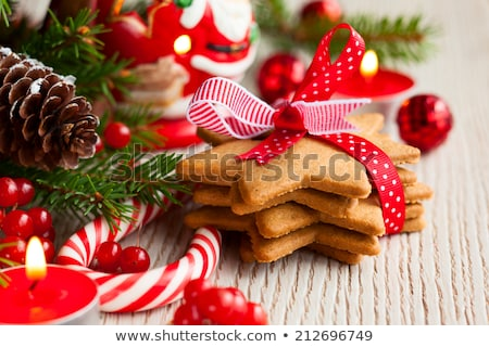 christmas fir decoration, candle, cookies and gift Stock photo © dolgachov