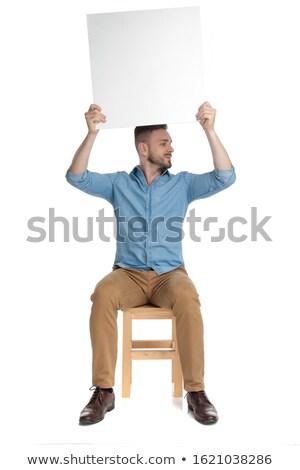 Férfi tart tábla levegő külső oldal Stock fotó © feedough