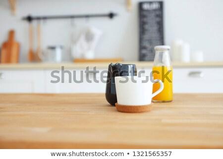 Fa asztal bögre tejesflakon narancslé elmosódott konyha Stock fotó © dashapetrenko