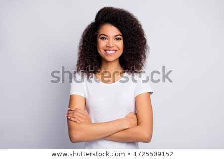 Portrait of a cheery young woman Stock photo © deandrobot