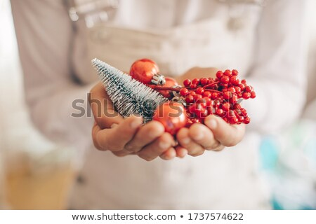 close up of woman holding christmas ball stock photo © dolgachov