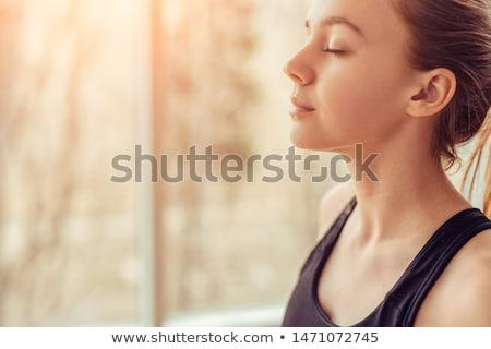 breathing deeply during yoga practice stock photo © pressmaster
