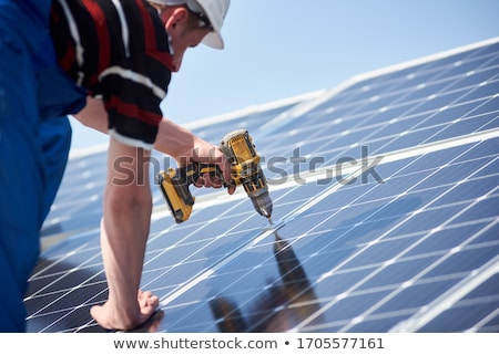 Building with Solar Batteries on Roof Installed Stock photo © robuart