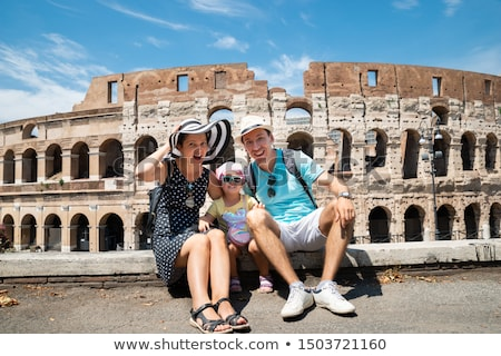 Young Family Sitting In Front Of Colosseum Stock photo © AndreyPopov