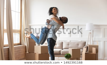 Young man and woman starting a family. Stock photo © lichtmeister
