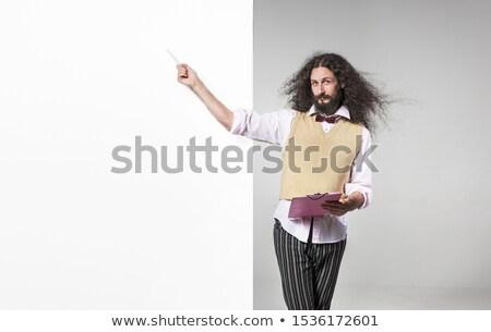 Skinny nerd pointing with a pen on the empty board Stock photo © majdansky