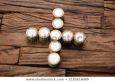 Stacked Coins Forming Plus Sign Stock photo © AndreyPopov