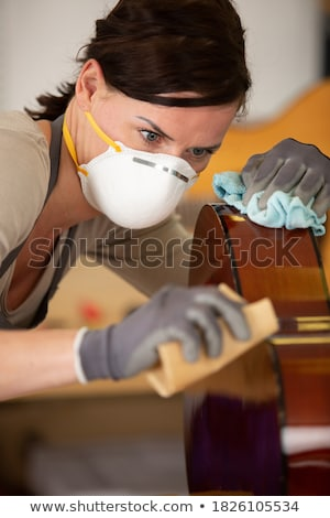 Woman Working As Lute Maker Polishing Classic Guitar Stock photo © diego_cervo