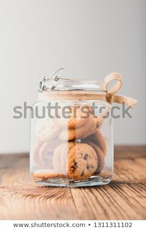 Büyük kavanoz yulaf kurabiye ayakta ahşap masa Stok fotoğraf © przemekklos