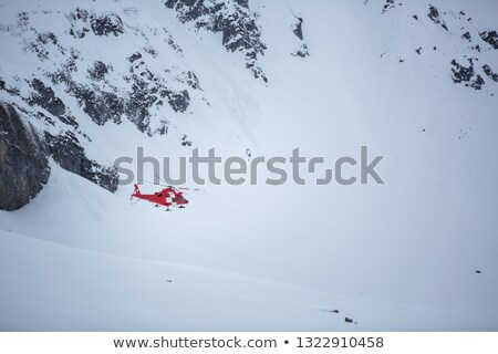 Modern medical helicopter flying in high mountains Stock photo © lightpoet