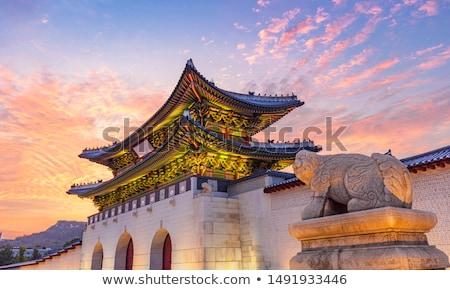 Stock photo: Woman tourist in korea. Korean palace grounds in Seoul, South Korea. Travel to Korea concept
