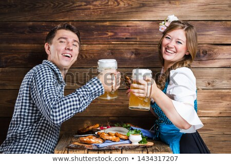 two bavarian women with beer and pretzels stock photo © rob_stark
