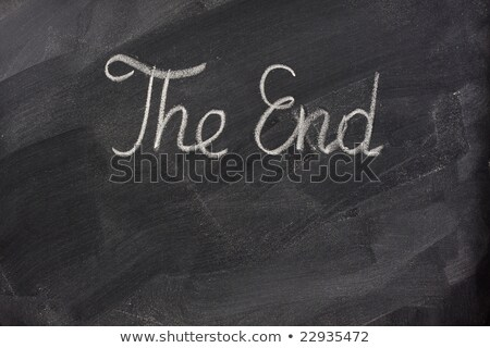 The end - handwritten with chalk on a blackboard with eraser smudges  Stock photo © bbbar