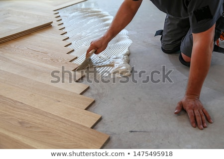Man fitting a wooden floor Stock photo © photography33