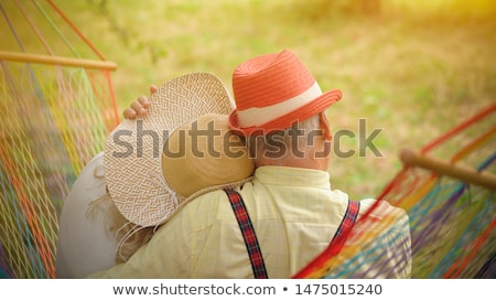 Happy couple sitting in a hammock Stock photo © photography33