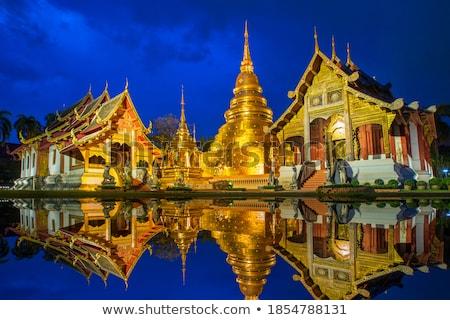 golden buddha in church at phra singh temple stock photo © nuttakit
