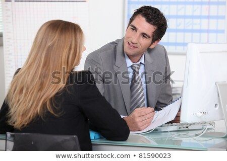 Man interviewing a young woman across a desk Stock photo © photography33
