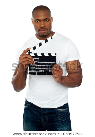 Masculine african male holding clapperboard Stock photo © stockyimages