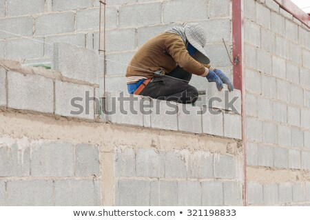 Bricklayer with trowel and cement block Stock photo © photography33
