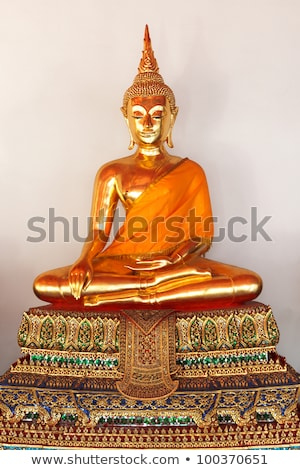 row of buddha statues in wat po temple stock photo © backyardproductions