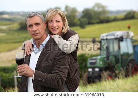 a mature man in a middle of a vineyard stock photo © photography33